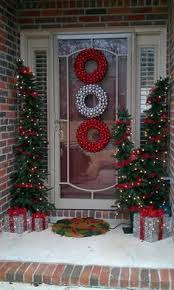 garland on porch entry bows and bells at top of columns and