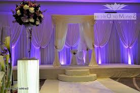 wedding stage decoration with flowers and lights decorating of party