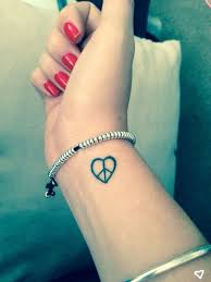 36 classic peace symbol wrist tattoos design