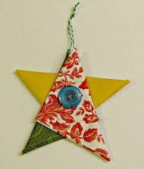 i learned how to make these adorable folded ornaments at my