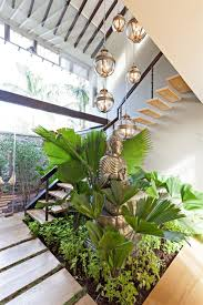 home design indoor courtyard with buddha statue refreshing the