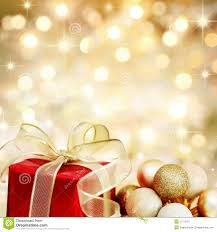 christmas gift and baubles on golden background royalty free stock