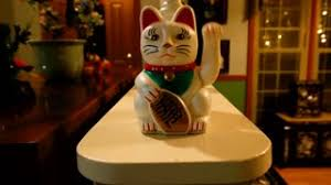 luck cat ornament waving stock footage
