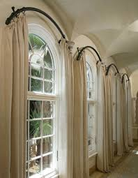 interior aged brown linen arch window drapes completed with cord