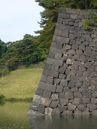 why are japanese castles built of wood as opposed to stone