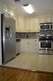 kitchens with different colored cabinets kitchen kitchen with table also with and storage besides