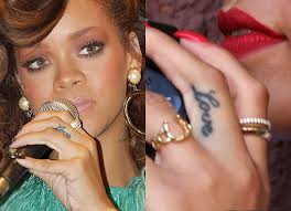 all rihanna tattoos and their meanings inkdoneright