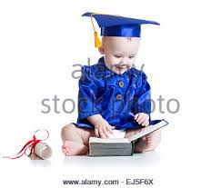 baby graduation cap and gown a boy student wearing graduation cap and cheering stock photo