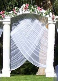 wedding arches designs filmy draping could use a more solid fabric if wanting to use
