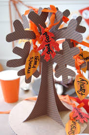 giving thanks a thanksgiving table paper trees