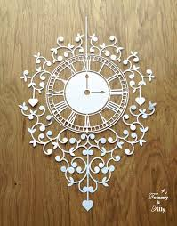 diy papercut clock design with permission to sell finished cuts
