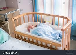 Baby Sleeping In A Crib by Newborn Baby Hospital Room New Born Stock Photo 300996413