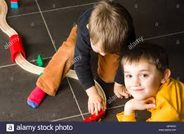 children playing with wooden toy train brothers build wooden