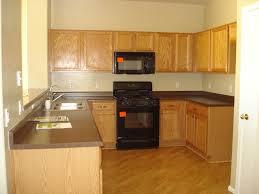 what are builder grade cabinets made of kashmir white granite littlehousebigplans