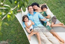 family relaxing in hammock stock photo getty images