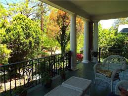 traditional porch with columns u0026 wrought iron railing in