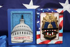 Flag Folded Into Triangle Image Of A United States Commemorative Capitol Police Badge And A