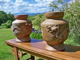 vintage pair large clay pots with dragon motif goshen