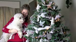 80 years old woman decorating christmas tree grandmother holiday