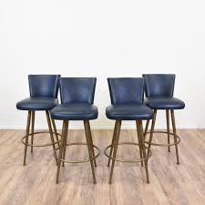 this set of 4 mid century modern barstools are featured in a