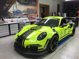 porsche 911 gt3 rs green blackbox team reveals a neat three layer vinyl body finish for a