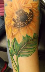 realistic color sunflower tattoo maybe a sunflower with two ms on