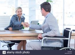 under the table jobs for disabled businesswoman interviewing disabled job candidate stock photo