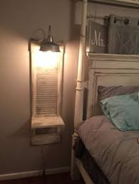 vintage window shutters repurpose tip junkie repurpose wood shutter idea for the bathroom i m so trying this