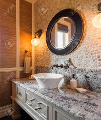 bathroom interior in new luxury home half bath with sink counter