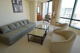 custom made low sofa and tub chairs