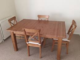 ikea stornas extending dining table and 4 ingolf chairs in
