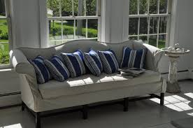 slipcovering the camelback sofa in linen would be beautiful