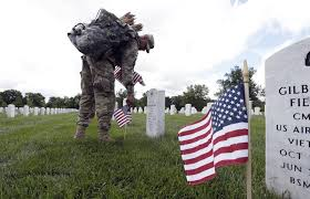why and when do we celebrate veterans day and memorial day