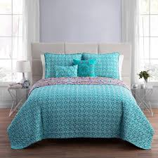 grey bed with modren style blue green pillows and blanket with