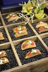 la bonne cuisine mini tacos served in bean filled boxes i la bonne cuisine catering
