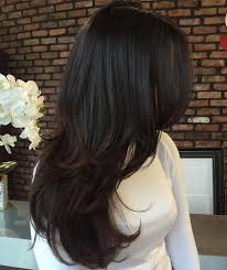 long dark chocolate brown wavy hair with layers in a v shape