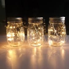 Mason Jar Arrangements Mason Jar Centerpieces Floating Candles Emmaline Bride