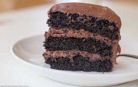 three layer chocolate cake with chocolate buttercream frosting