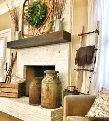 simple fireplace painted brick and wood mantel