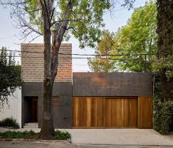 dcpp arranges dark walled mexico city house around two courtyards