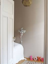 the nursery painted in the dusty pink color soft skin from lady