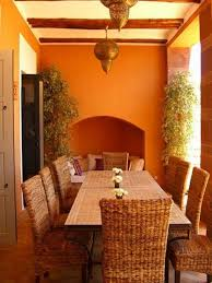 classic outdoor moroccan dining room design with rattan chairs