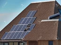 solar panels on roof solar panels on a modern house with thatched roof stock photo