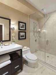 bathroom with walk in shower and framed wall pictures bathroom