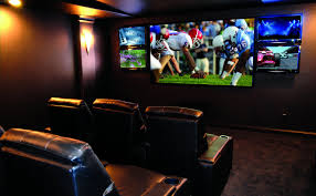 Home Theater Decorating Large Screen And Lamps On The Cream Wall Combined With Black