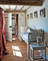 country hallway with whitewashed bench and exposed beams english