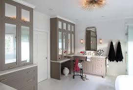 gray mirrored bath vanity cabinets with brass pulls transitional