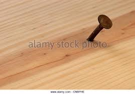 nail in wood texture stock photos nail in wood