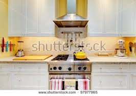 Yellow Kitchen With White Cabinets - kitchen cabinets stock images royalty free images u0026 vectors