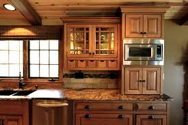 quartersawn oak cabinets in a rustic kitchen decora cabinetry
